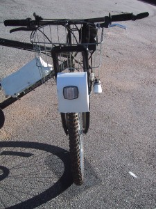 motor mounted over the front tire of a bicycle using PVC pipe