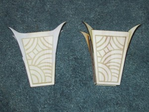 Two mysterio bracers, one with filleting using sculpy