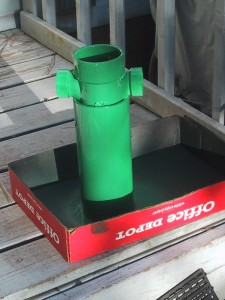 "One foot of 4"" pvc pipe, with a 3 way T on the top, painted green."