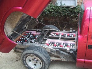 16 six volt batteries under the tilt-bed of the pickup