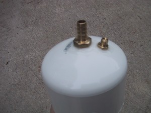 """3"""" pvc pipe cap with a hose bib and vacuum gauge connection inserted"""