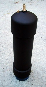 "a foot of 3"" PVC pipe with end caps painted black."