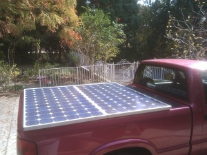 Two 175 watt solar panels mounted to the bed cover of my electric pickup truck.