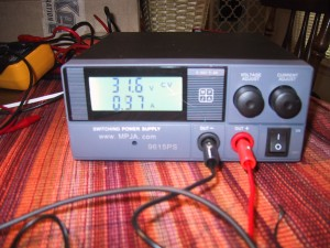 a small bench powersupply. Two knobs for volts/amps, and an on-off switch plus an LCD display.