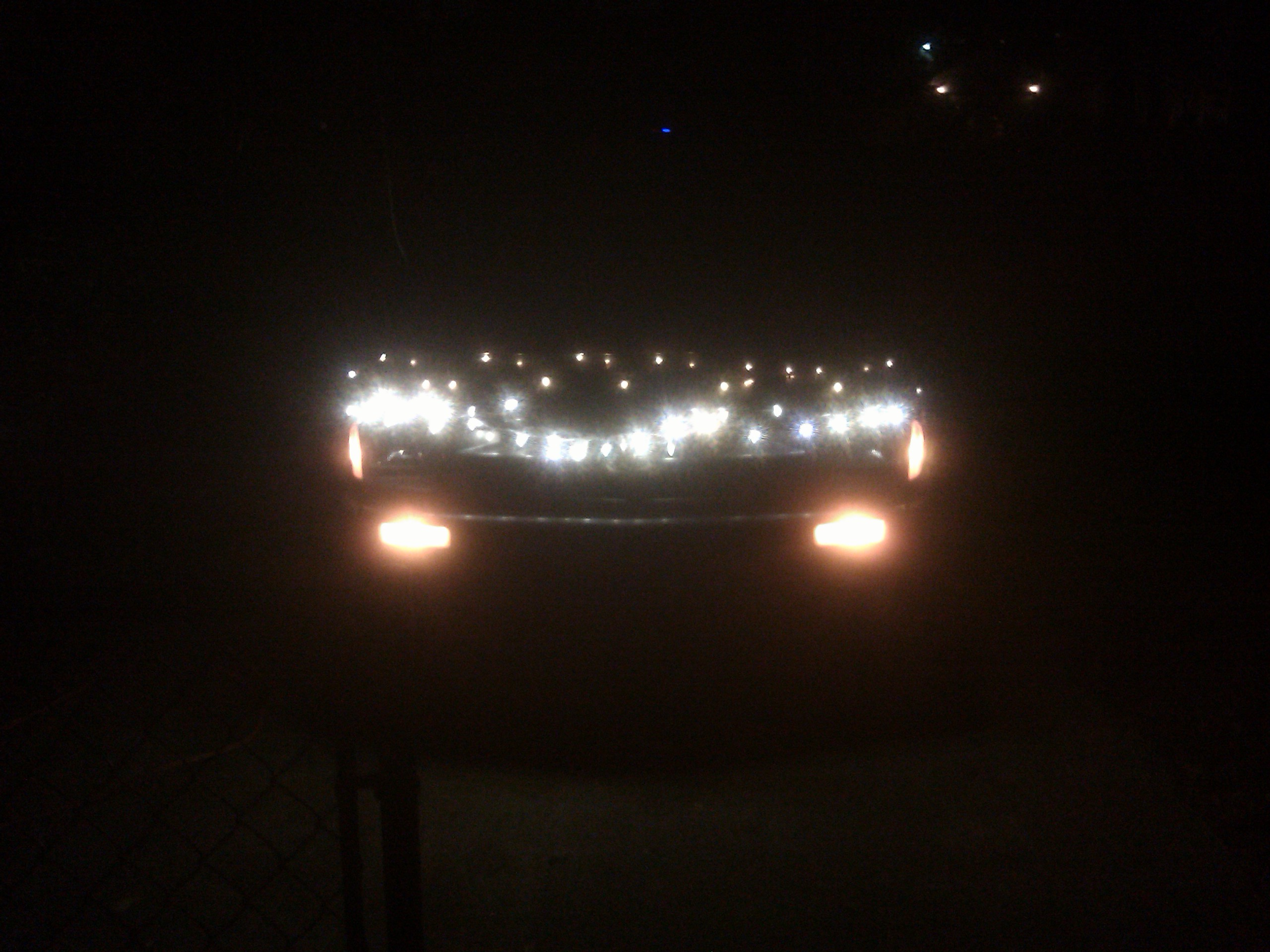 christmas lights on the front of a truck