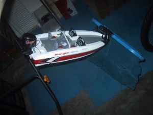 Radio Controlled boat with pool net taped to the front