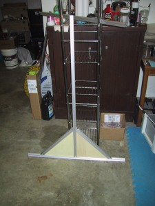 One side panel of the frame, triangular bottom with a tall upright in the center