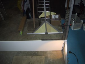 using a carpenters square on the frame