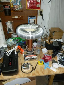 flexible alunimum ducting wraped around a circular wood form atop a oneTesla coil.
