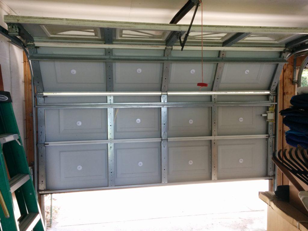 Garage door insulation part 1 fiberglass door for Door insulation