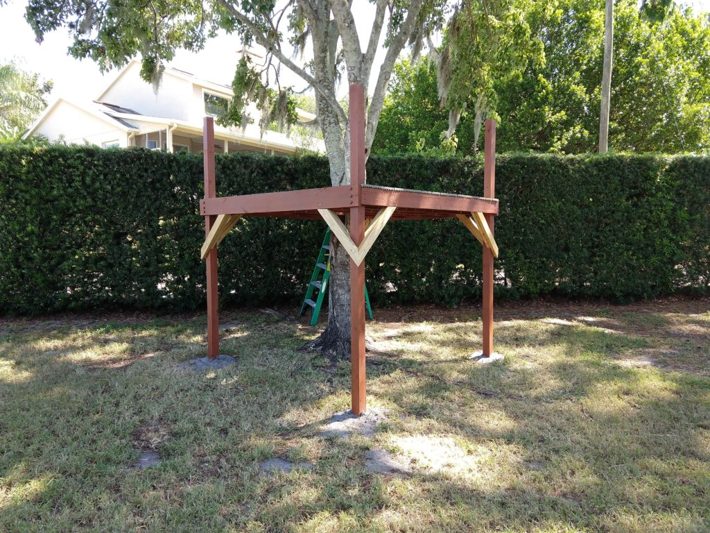 8 foot by 8 foot play structure around a tree
