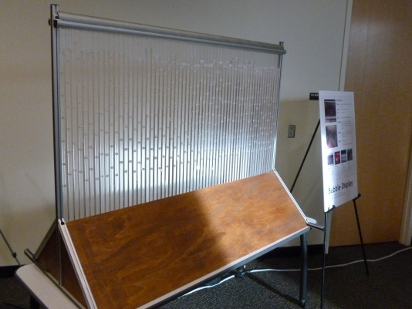Wood and Aluminum frame with sixty square tubes.